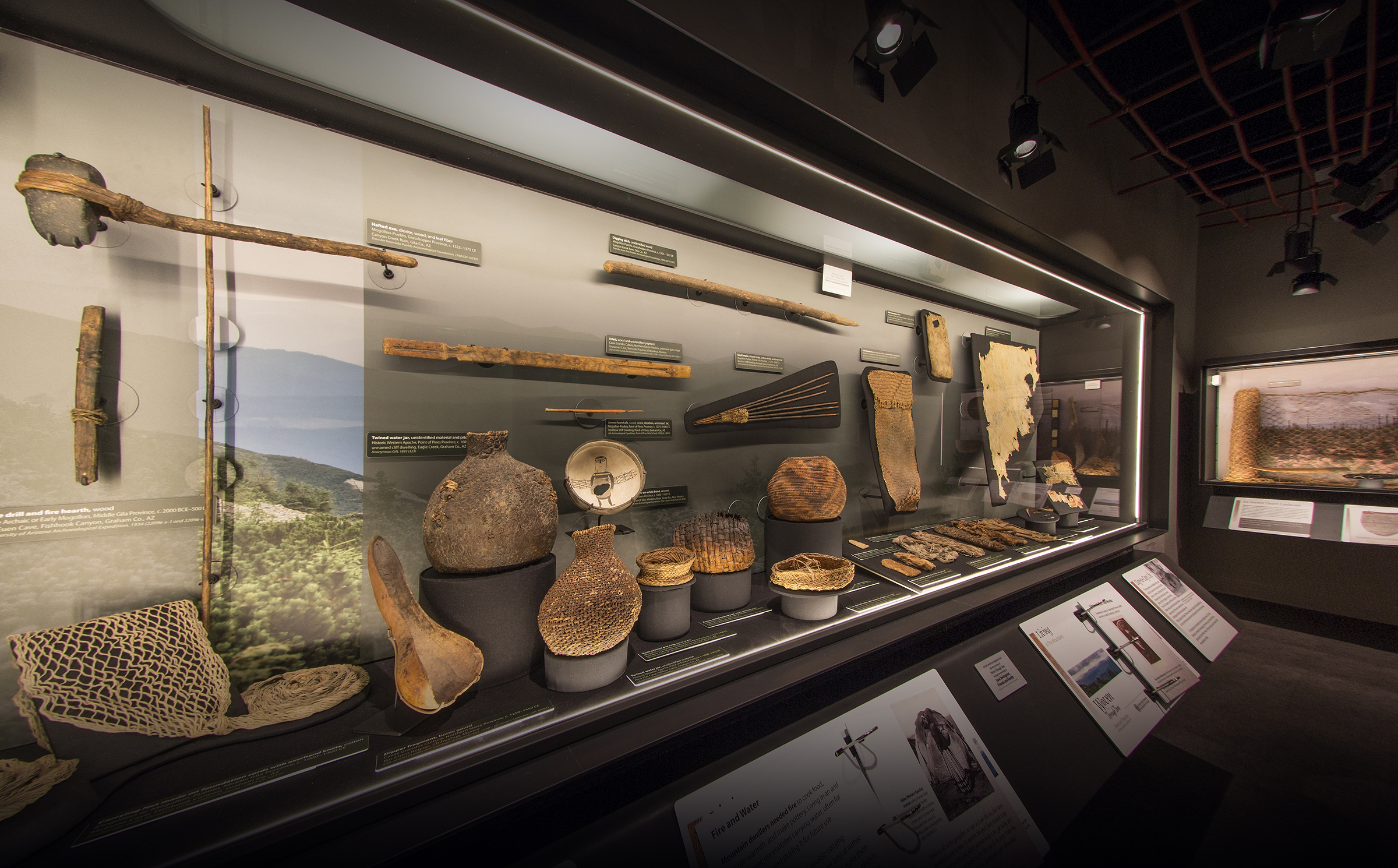 This image shows a view into one of the cases displaying archaeological basketry and other fiber objects.
