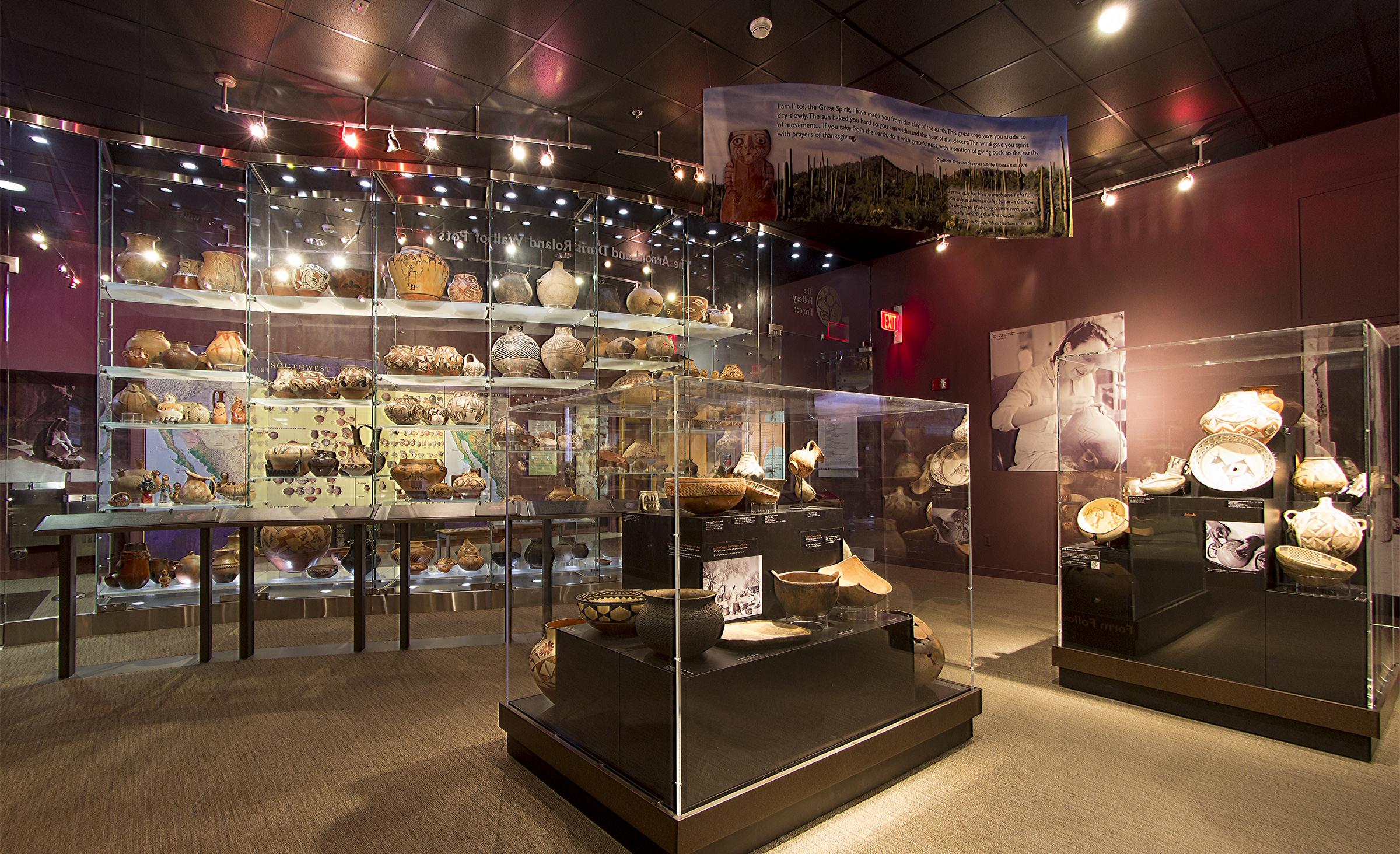 This images shows a view of the pottery gallery display cases and the Wall of Pots.
