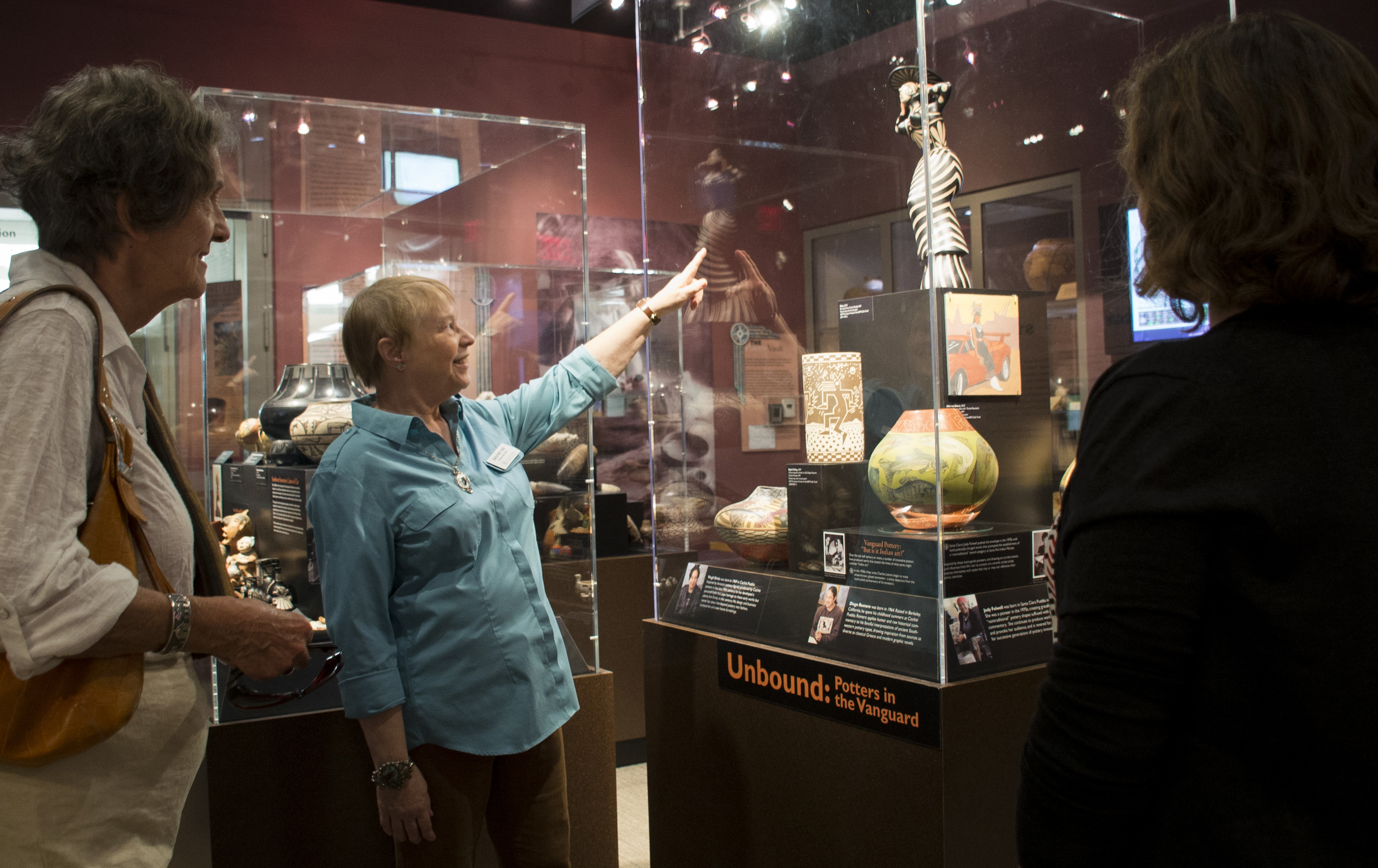 Docents point out important details in the exhibits