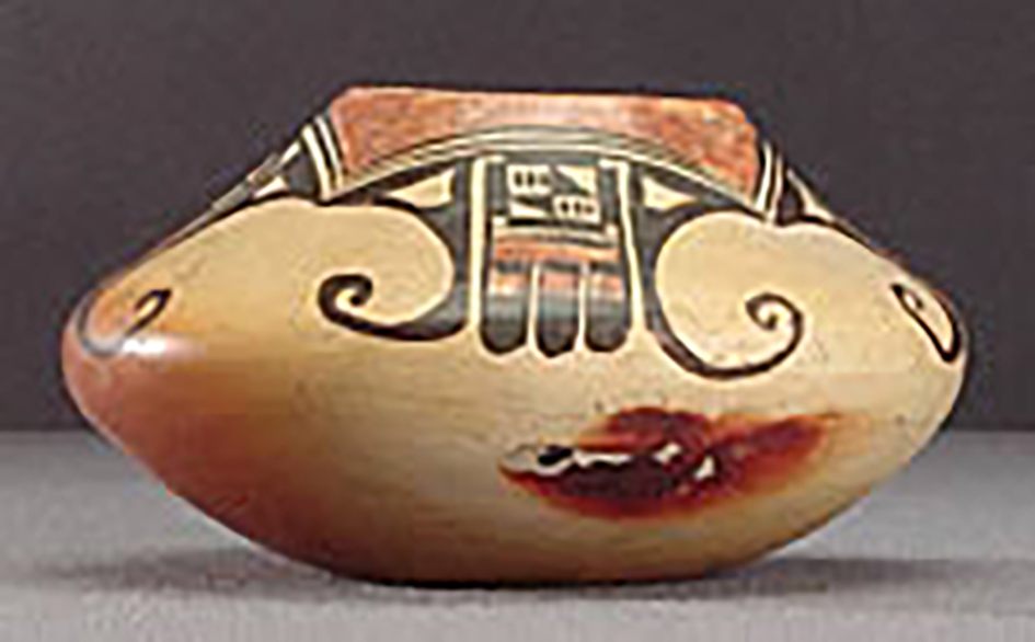 Side view, small polychrome jar with abstract eagle motifs, around 1900-1910. (ASM 80-45-2).