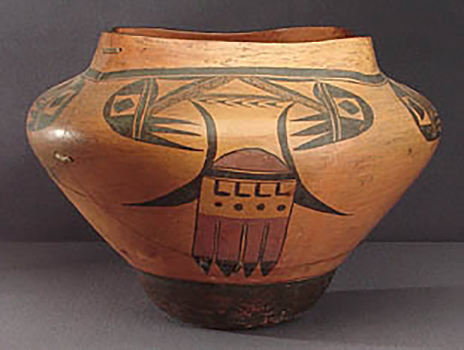 Side view, large square top polychrome olla, around 1920-30. GP52543.