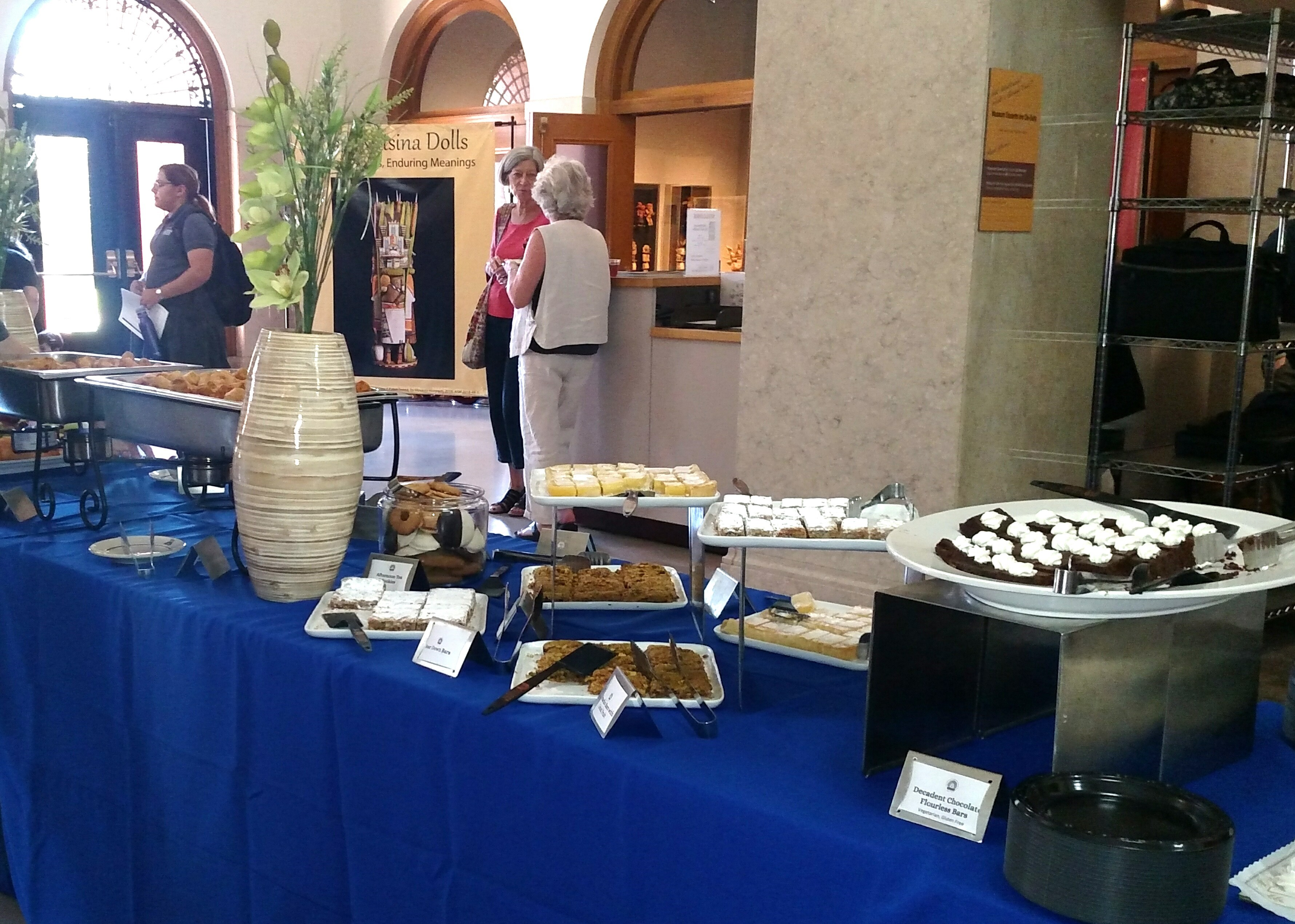 This image shows catered food displayed on a table with a blue tablecloth