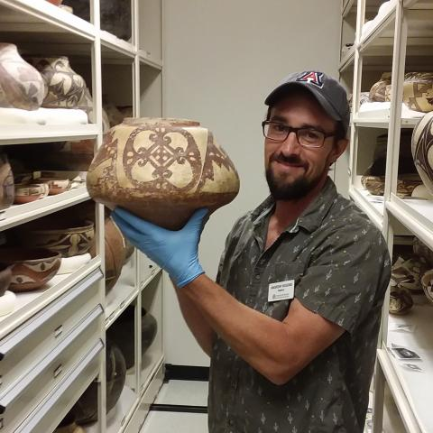 Registrar Andrew Higgins in the pottery vault.