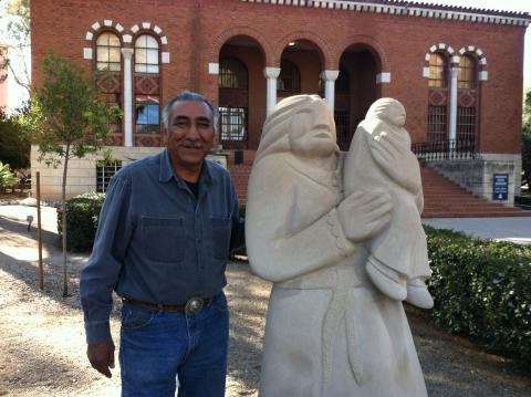 Artist John Suazo (Pueblo of Taos) with his sculpture, Waiting for Grandfather, in 2013