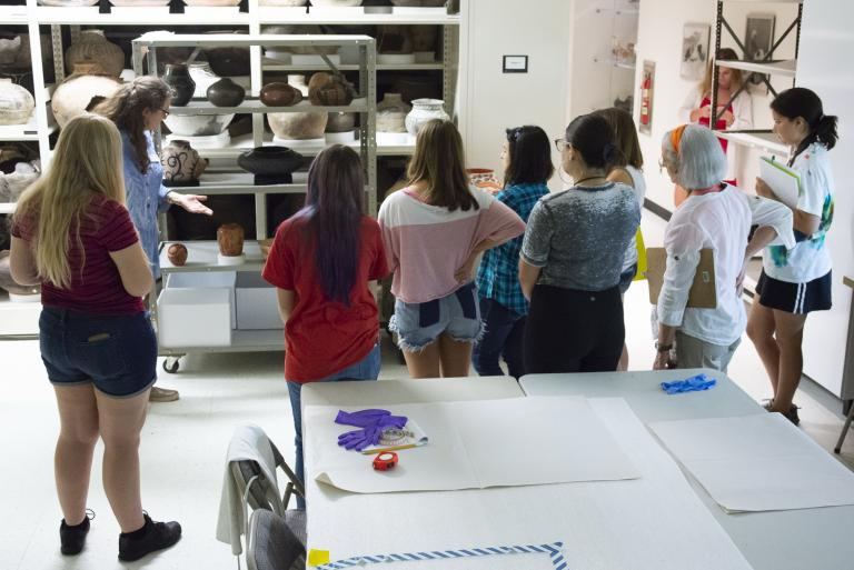 Diane Dittemore, associate curator of ethnology, giving a tour to a University of Arizona art history class