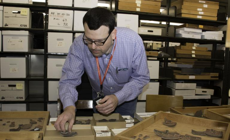 Dr. Patrick D. Lyons analyzes pottery from Point of Pines Pueblo (San Carlos Apache Reservation, southeast Arizona).